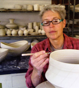 Silvie Granatelli working on a pot in her studio.