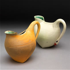 Two swan handle pitchers, 5